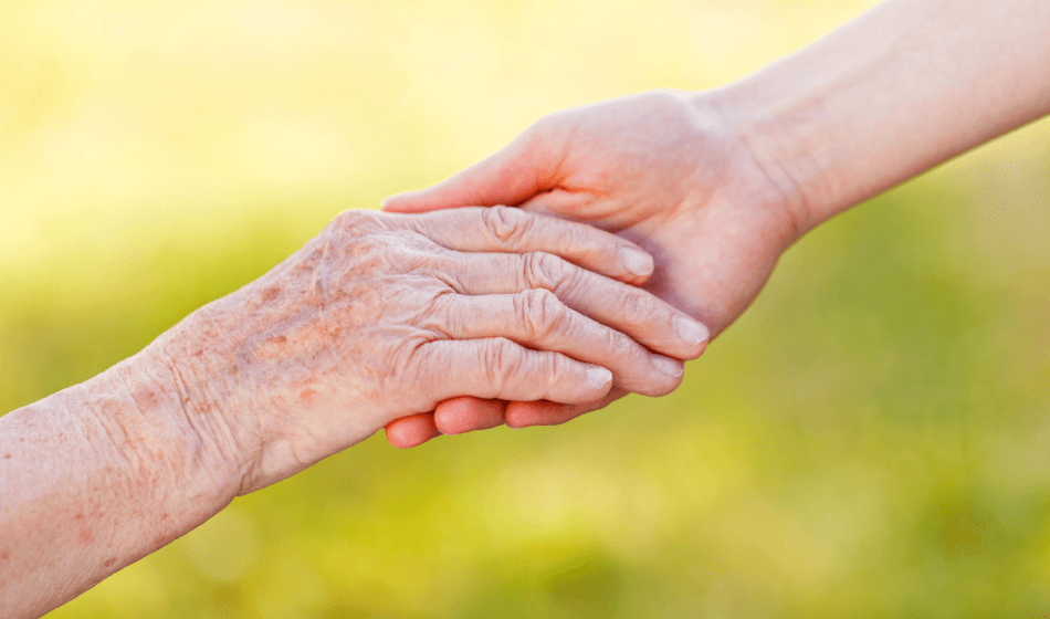 helfende hand in der letzten lebensphase